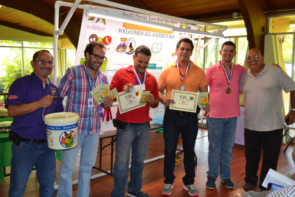 Left to right: Simbad's Pet Shop Fernando Dona presented a Quiko award. Mr. Jose De Cote presenting the Best in Show award to Armando Rodriguez, 2nd place Oscar Bouza, 3rd place Fabio Tarazona and 4th place Luis Gonzalez.